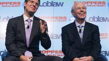 Executive chairman of Loblaw Companies Limited Galen G. Weston and Chair of the Board of Directors of Shoppers Drug Mart Holger Kluge (R) speak during a news conference in Toronto, July 15, 2013. (MARK BLINCH/REUTERS)