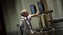 A trader looks at computer screens at the Madrid bourse. (SUSANA VERA/REUTERS)