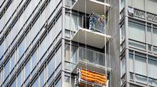 Workers removing glass panels from the balconies of a Lanterra condominium at the corner of Bay and Grosvenor Sts. in downtown Toronto. (Fred Lum/The Globe and Mail/Fred Lum/The Globe and Mail)