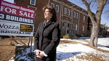 Anna Vozza, President of the Windsor/Essex Real Esate Board stands in front of an investment property consisting of 3 buildings close to downtown Windsor, February 18, 2010. The 3 properties have an asking price of $600,000. (GEOFF ROBINS For The Globe and Mail)