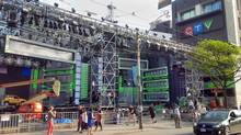 Technicians set the stage on Thursday, June 12, for Sunday's MuchMusic Video Awards, in the parking lot of Bell Media's broadcast centre on Queen Street West in downtown Toronto. (SIMON HOUPT/THE GLOBE AND MAIL)