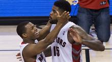 Toronto Raptors guard Kyle Lowry, left, celebrates AmirJohnson's late game basket against the Brooklyn Nets during second half NBA playoff basketball action in Toronto on Tuesday, April 22, 2014. (The Canadian Press)