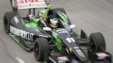 France's Sebastien Bourdais races around the course on his way to winning the first Toronto Indy race of the day in Toronto on Sunday, July 20, 2014. (Frank Gunn/THE CANADIAN PRESS)