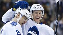 Toronto Maple Leafs defenceman's Luke Schenn, left, and Carl Gunnars