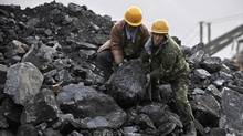 Miners work at a coal mine in Fuxin, Liaoning, in this 2009 photo. (SHENG LI/SHENG LI/REUTERS)