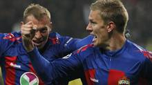 CSKA Moscow's Pontus Wernbloom celebrates after scoring against Real Madrid with teammate Vasili Berezutski. (TATYANA MAKEYEVA/Reuters)