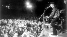 Aug. 4, 1974. Stompin' Tom Connors in concert in 1974 at the Ontario Place Forum. (John McNeill/The Globe and Mail)