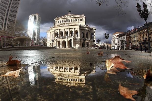 Dark clouds hang over the Old Opera in Frankfurt, Germany. Germany embarked on a large-scale program, nationally and across its 16 state governments, designed to equalize the percentage of women and men in the work force.