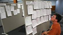 Former Electro Motive Diesel employee Garnet Cooke, looks over the job boards in London, Ont. A new Conference Board of Canada study says Ontario's skills gap is costing the province up to $24-billion annually. (Deborah Baic/The Globe and Mail)