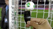The goal-line monitoring device is demonstrated before the media at Yokohama Stadium in Japan (Shuji Kajiyama/AP)