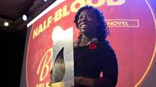 Esi Edugyan accepts the Scotiabank Giller Prize for her book Half-Blood Blues in Toronto on Tuesday. (Chris Young/The Canadian Press)