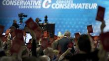 Prime Minister Stephen Harper speaks to delegates during a policy plenary session during the Conservative convention in Calgary on Nov. 2, 2013. The Conservative Party's chief fundraiser says he refused to dip into party funds to repay Senator Mike Duffy's roughly $90,000 in questionable expense claims. (JONATHAN HAYWARD/THE CANADIAN PRESS)