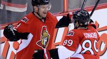 Ottawa Senators' Milan Michalek, left, celebrates a first period goal with teammate Cory Conacher against the Winnipeg Jets' during NHL hockey action in Ottawa on Thursday, Jan. 2, 2014. (Sean Kilpatrick/THE CANADIAN PRESS)