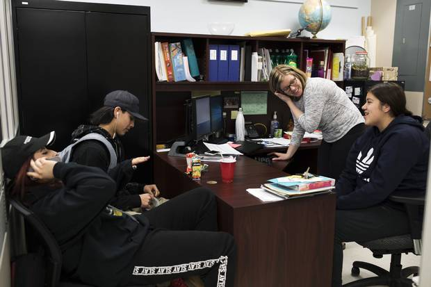 A typical lunch hour at Dryden High School: Students drop in to spend time with graduation coach Kieran McMonagle. If they're hungry, they can always help themselves to snacks.
