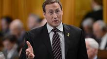 Minister of Defence Peter MacKay responds to a question in the House of Commons on March 4, 2013. Spending on external contracting rose by $500-million between 2009 and 2011, the year retired lieutenant-general Andrew Leslie advised the department it could safely cut 30 per cent of those agreements. (Sean Kilpatrick/The Canadian Press)
