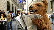 A person dressed as a bear to represent a bear market performs outside the New York Stock Exchange on October 6, 2008 in New York. (TIMOTHY A. CLARY/2008 AFP)