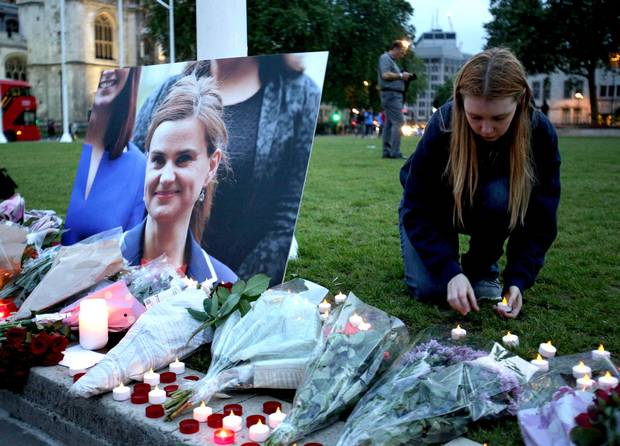 A mourner pays tribute to slain Labour MP Jo Cox at a vigil in Parliament square in London on June 16, 2016.