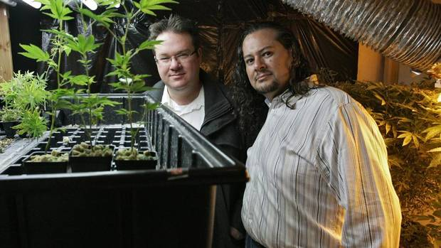 Brennan Thicke, left, a founder of the Venice Beach Care Center, and Rigo Valdez, an organizing director with United Food and Commercial Workers union (UFCW), pose together at the medical marijuana dispensary in Los Angeles, Feb. 6, 2013. (JONATHAN ALCORN/REUTERS)
