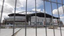 Construction continues at Investors Group Field, after the Bombers' CEO announced delays in construction in Winnipeg on June 15, 2012. Starting in 2013, CFL fans in four Canadian cities are looking forward to shiny new stadiums, packed with goodies to make watching football more enjoyable and more expensive. (Trevor Hagan/THE CANADIAN PRESS)