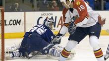 Florida Panthers Nathan Horton misses a wide open net behind sprawling Toronto Maple Leaf goalie Vesa Toskala during first period action of their NHL hockey game in Toronto, January 6, 2009. REUTERS/Fred Thornhill (FRED THORNHILL)