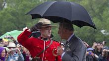 Prince Charles is saluted by a member of the RCMP as he arrives at the Saskatchewan Legislature during a light downpour in Regina, on May 23, 2012 . (Paul Chiasson/The Canadian Press/Paul Chiasson/The Canadian Press)