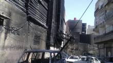 A general view of the damage at al-Midan neighbourhood in Damascus July 23, 2012. (Shaam News Network/Reuters)