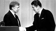 Incumbent Democratic president Jimmy Carter and Republican challenger Ronald Reagan, shake hands on Oct. 28, 1980, before debating. (Associated Press)