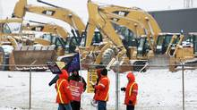 Electro-Motive workers picket a Caterpillar equipment dealership in London, Ont., on January 26, 2012. (DAVE CHIDLEY/DAVE CHIDLEY/THE CANADIAN PRESS)