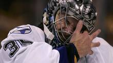 Tampa Bay Lightning goalie Dwayne Roloson wipes his face durng the second period. REUTERS/Adam Hunger (ADAM HUNGER)