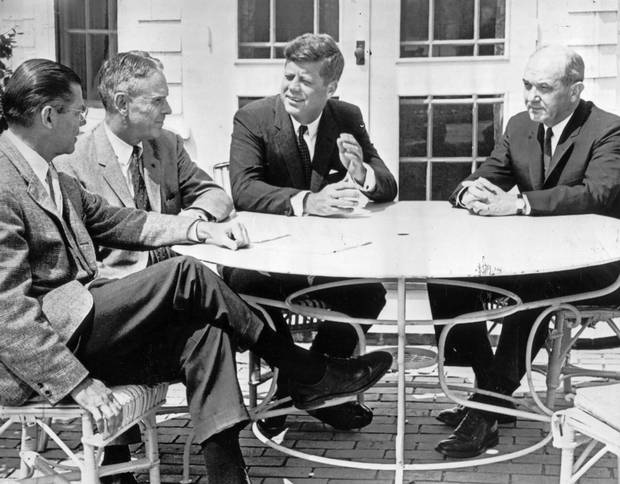 July 8, 1961: President John F. Kennedy meets on the patio of his summer home in Hyannis Port, Mass., with secretary of defence Robert McNamara, General Maxwell Taylor and Dean Rusk, Secretary of State.