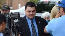 MP Dean Del Mastro is followed by media as he leaves court during a recess in Peterborough, Ont. on Monday June 23, 2014. (Sean Kilpatrick/The Canadian Press)