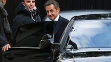 "Former French President Nicolas Sarkozy enters a car as he leaves his residence in Paris on March 25, 2013. Sarkozy was placed under formal investigation on Thursday for ""abuse of weakness"" in a 2007 party funding case involving elderly L'Oreal heiress Liliane Bettencourt, the public prosecutor said. (CHARLES PLATIAU/REUTERS)"