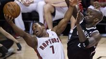 Toronto Raptors guard Kyle Lowry gets fouled by Brooklyn Nets forward Kevin Garnett, right, during first half NBA game seven playoff basketball action in Toronto on May 4. (Nathan Denette/THE CANADIAN PRESS)