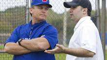 Toronto Blue Jays manager John Gibbons (L) talks to general manager Alex Anthopoulos during team work outs at the team's MLB baseball spring training facility in Dunedin, Florida February 20, 2013. (FRED THORNHILL/REUTERS)