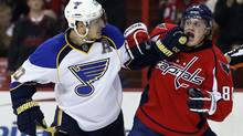 St. Louis Blues left wing Alexander Steen (20) scuffles with Washington Capitals defenseman Nate Schmidt (88) in the second period of an NHL hockey game, Sunday, Nov. 17, 2013, in Washington. (ALEX BRANDON/AP)