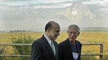 With the Teton Mountains behind them, U.S. Federal Reserve chairman Ben Bernanke, left, and Bank of Israel Governor Stanley Fischer walk together outside of the Jackson Hole Economic Symposium in this 2012 file photo. Mr. Bernanke, who has often used the gorgeous setting to outline his views on future policy, was conspicuous by his absence at this year's event. (Ted S. Warren/The Associated Press)