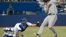 Tampa Bay Rays Will Myers eludes the tag of Toronto Blue Jays catcher J.P. Arencibia to score during ninth inning AL action Toronto on Friday July 19, 2013. (Frank Gunn/THE CANADIAN PRESS)