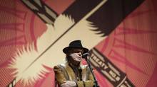 "Singer Neil Young speaks during a news conference before the last concert in his ""Honour the Treaties"" tour in Calgary, Sunday, Jan. 19, 2014. (Jeff McIntosh/THE CANADIAN PRESS)"