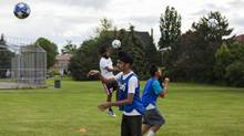 Shehnajdeep Brar, 15, wears a turban as he performs drills during a soccer practice with the Sikh Sports Club house league at Cherrytree public School in Brampton. (Philip Cheung For The Globe and Mail)
