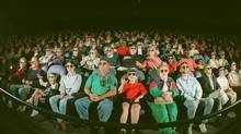 Viewers in an Imax theatre in Chattanooga, Tenn., wear polarizing glasses. (John Coniglio/The Associated Press)