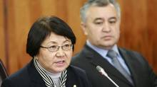 Roza Otunbayeva, left, the interim government leader speaks as she sits next to Vice-Premier Omurbek Tekebayev during a news conference in Bishkek on Thursday. (Vladimir Pirogov/Reuters)