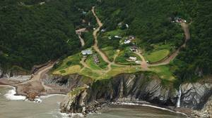 Aerial photo shows the community of Meat Cove on Cape Breton after the only road in and o