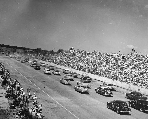 DARLINGTON, SC - 1950'S: (L-R) Fonty Flock, Tim Flock, Junior Johnson, Herb Thomas. Two Oldsmobiles and two Hudson Hornets race in Darlington, South Carolina in the 1950's. (Photo by ISC Archives via Getty Images)