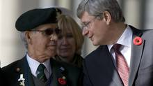 Prime Minister Stephen Harper speaks with Canadian Veteran Arsene Dube during a Remembrance Day ceremony at the Korean War Memorial in Seoul. (Adrian Wyld/The Canadian Press)