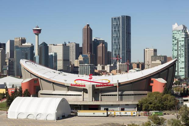 Debate about whether to bid for the 2026 Winter Olympics comes as the city also considers whether to replace its iconic Saddledome arena.