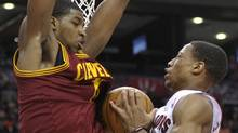 Toronto Raptors forward DeMar DeRozan and Cleveland Cavaliers defender Tristan Thompson (L) collide under the basket during the first half of their NBA basketball game in Toronto April 6, 2012. REUTERS/Mike Cassese (Mike Cassese/Reuters)