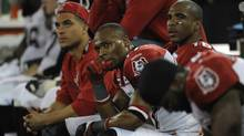 Members of the Calgary Stampeders on the bench with seconds left in their Grey Cup loss to the Toronto Argonauts on Nov 25 2012. (Fred Lum/The Globe and Mail)