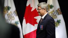 Prime Minister Stephen Harper participates in a Queen Elizabeth II Diamond Jubilee medal presentation in Calgary, Alta., Oct. 9, 2012. (Jeff McIntosh/THE CANADIAN PRESS)