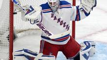 New York Rangers goalie Henrik Lundqvist (30) makes a save against the Montreal Canadiens during first period in game two of the NHL Eastern Conference final Stanley Cup playoff action Monday, May 19, 2014 in Montreal. (Ryan Remiorz/THE CANADIAN PRESS)