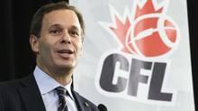CFL commissioner Mark Cohon speaks before awarding the Jake Gaudaur Veterans' Trophy to Saskatchewan Roughriders player Graeme Bell in Toronto November 21, 2012. (Reuters)